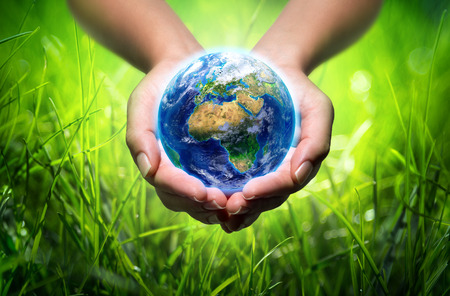 earth in hands - grass - environment concept - Europe
