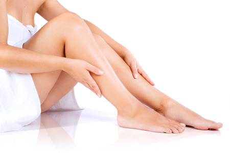 Photo pour Woman legs and hands, in towel - image libre de droit