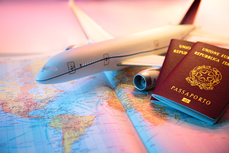 Foto de trip in America - passport, airplane and map of world - Imagen libre de derechos