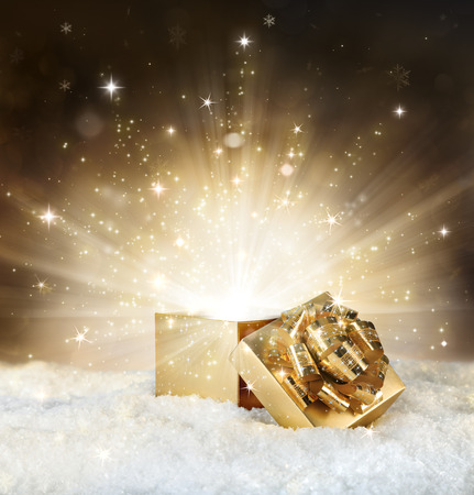 Photo for magic shining of christmas gift - golden stardust and snow - Royalty Free Image