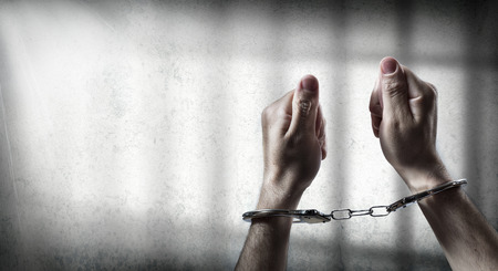 Photo for arrest  man handcuffed in cell prison - Royalty Free Image