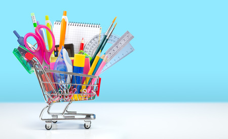 Foto de school supplies in shopping cart - back to school - Imagen libre de derechos