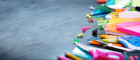 Photo for School and office supplies on blackboard - Royalty Free Image