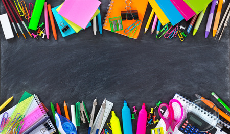 Foto de School and office supplies double border on blackboard - Imagen libre de derechos
