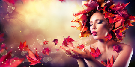 Photo pour Autumn woman blowing red leaves - Beauty Fashion Model Girl - image libre de droit