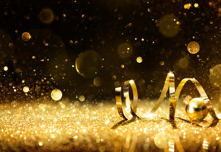 Photo for Golden Streamers With Sparkling Glitter - Royalty Free Image