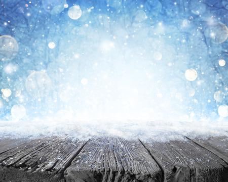 Foto de Snowy Plank With Wintery Forest Background - Imagen libre de derechos