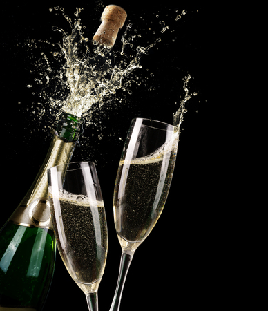 Photo for Popping Champagne And Toast Of Midnight - Royalty Free Image