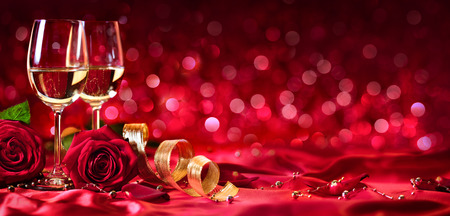 Foto de Romantic Celebration Of Valentine's Day - With Wine And Roses - Imagen libre de derechos