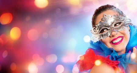 Photo pour Attractive Woman Smiling With Carnival Mask - image libre de droit
