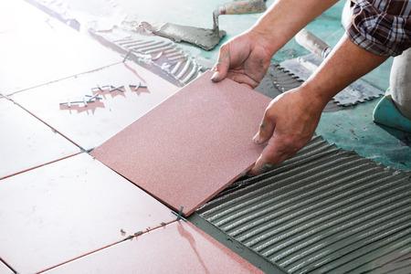Photo pour Installing Tiles - Professional Mason - image libre de droit