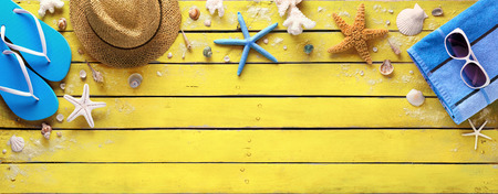 Photo for Beach Accessories On Yellow Wooden Plank - Summer Colors - Royalty Free Image