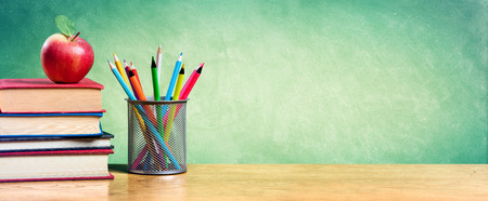 Photo pour Apple On Stack Of Books With Pencils And Blank Chalkboard - Back To School - image libre de droit