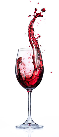 Photo pour Red Wine Splashing In Glasses - image libre de droit