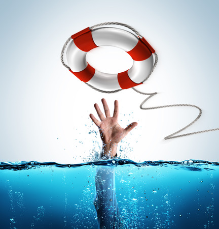 Photo for Rescue Concept - Businessman In Lifebelt To Help Drowning - Royalty Free Image