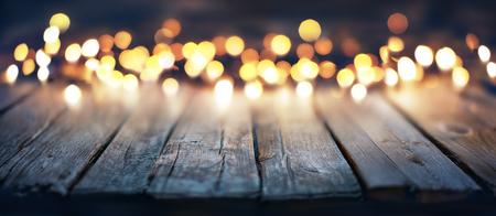 Photo pour Bokeh Of Christmas Lights On Vintage Wooden Plank - image libre de droit