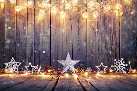 Photo pour Vintage Christmas Decoration With Stars And Lights On Wooden Table - image libre de droit