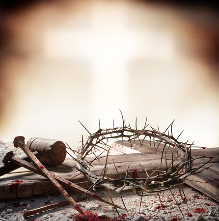 Photo for Crucifixion Of Jesus Christ - Cross With Bloody Hammer Nails And Crown Of Thorns - Royalty Free Image