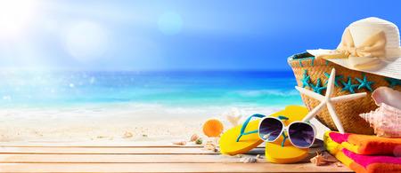Foto de Beach Accessories On Deck Beach - Summer Holidays - Imagen libre de derechos
