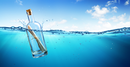 Photo for Message In Bottle Floating In The Ocean - Royalty Free Image