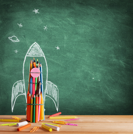 Photo pour Back To School - Rocket Sketch On Blackboard - image libre de droit