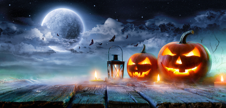 Photo for Jack Oâ € ™ Lanterns Glowing At Moonlight In The Spooky Night - Halloween Scene - Royalty Free Image