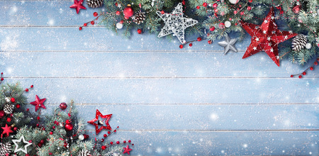 Foto de Christmas Background - Fir Branches And Baubles On Snowy Plank - Imagen libre de derechos
