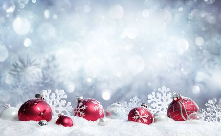 Foto de Christmas Card - Red Baubles And Snowflakes With Snowfall - Imagen libre de derechos