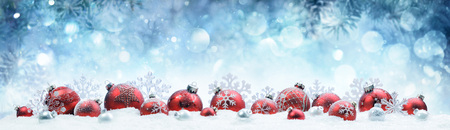 Photo pour Christmas - Decorated Red Balls And Snowflakes On Snow - image libre de droit