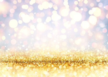 Foto de Golden Glitter On A Shiny Backdrop With Blurred Lights - Imagen libre de derechos