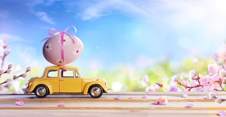 Photo pour Deformed And Unrecognizable Car Carrying Easter Egg - image libre de droit