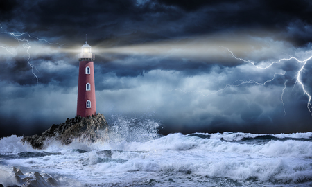 Photo pour Lighthouse In Stormy Landscape - Leader And Vision Concept - image libre de droit