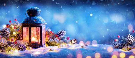 Foto de Christmas Decoration - Lantern With Ornament On Snow - Imagen libre de derechos