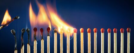 Photo for Matches Lit In Row Burning In Chain Reaction - Royalty Free Image