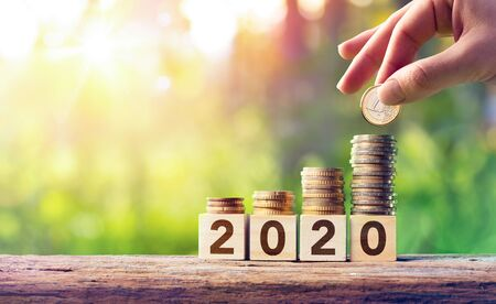 Foto de Growth Forecast Concept For 2020 - Coins Stack On Wooden Blocks - Imagen libre de derechos