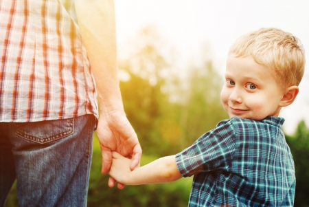 Photo for Father and son holding hand in hand - Royalty Free Image