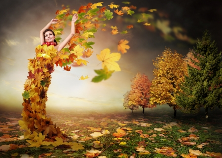 Abstract autumn image. Lady Autumn with leaves wings