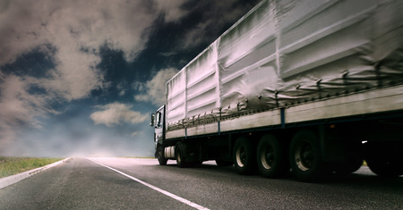 Photo for Big tented truck on the lonely highway - Royalty Free Image