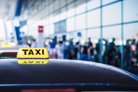 Photo for Taxi car waiting arrival passengers in front of Airport Gate - Royalty Free Image