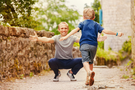Photo for Son runs to daddy s arms  - Royalty Free Image