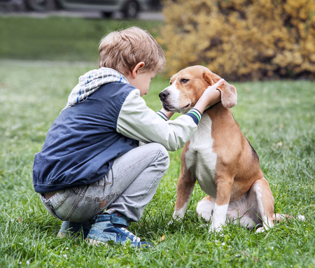 Photo for Two best friends - boy and his dog - Royalty Free Image