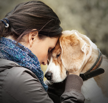 Photo pour Woman with her dog tender scene - image libre de droit
