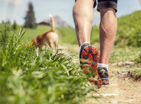 Photo pour Man legs on the mountain footpath close up image - image libre de droit