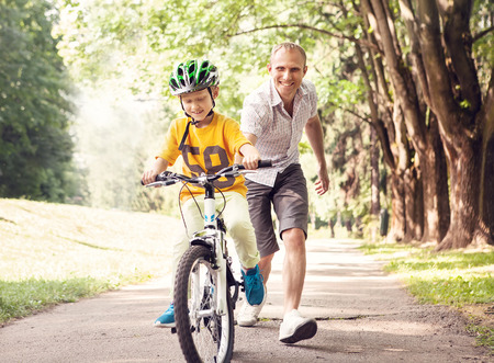 Photo for First lessons bicycle riding - Royalty Free Image