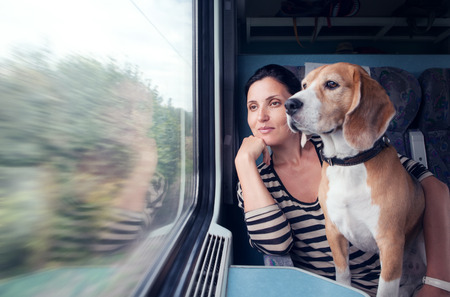 Photo for woman on train with dog - Royalty Free Image