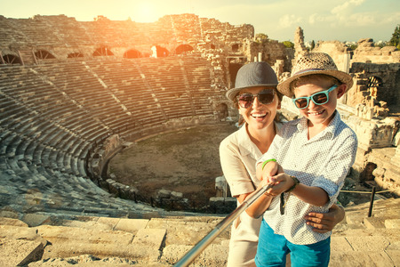 Foto de Mother with son take a selfie photo in antique theatre - Imagen libre de derechos