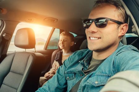 Photo pour Father with son go in car - image libre de droit