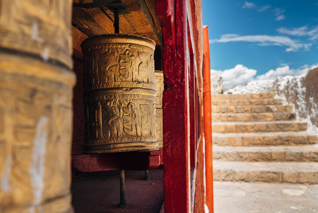 Photo pour Tibetan prayer wheels with a stairs background - image libre de droit
