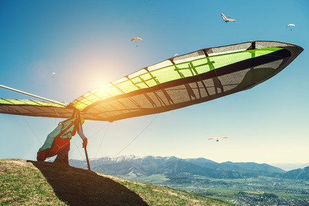 Photo for Hang-glider starting to fly - Royalty Free Image