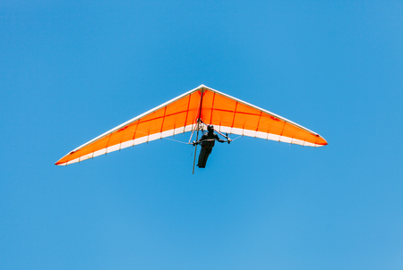 Photo pour Soaring hang gliding in the sky - image libre de droit